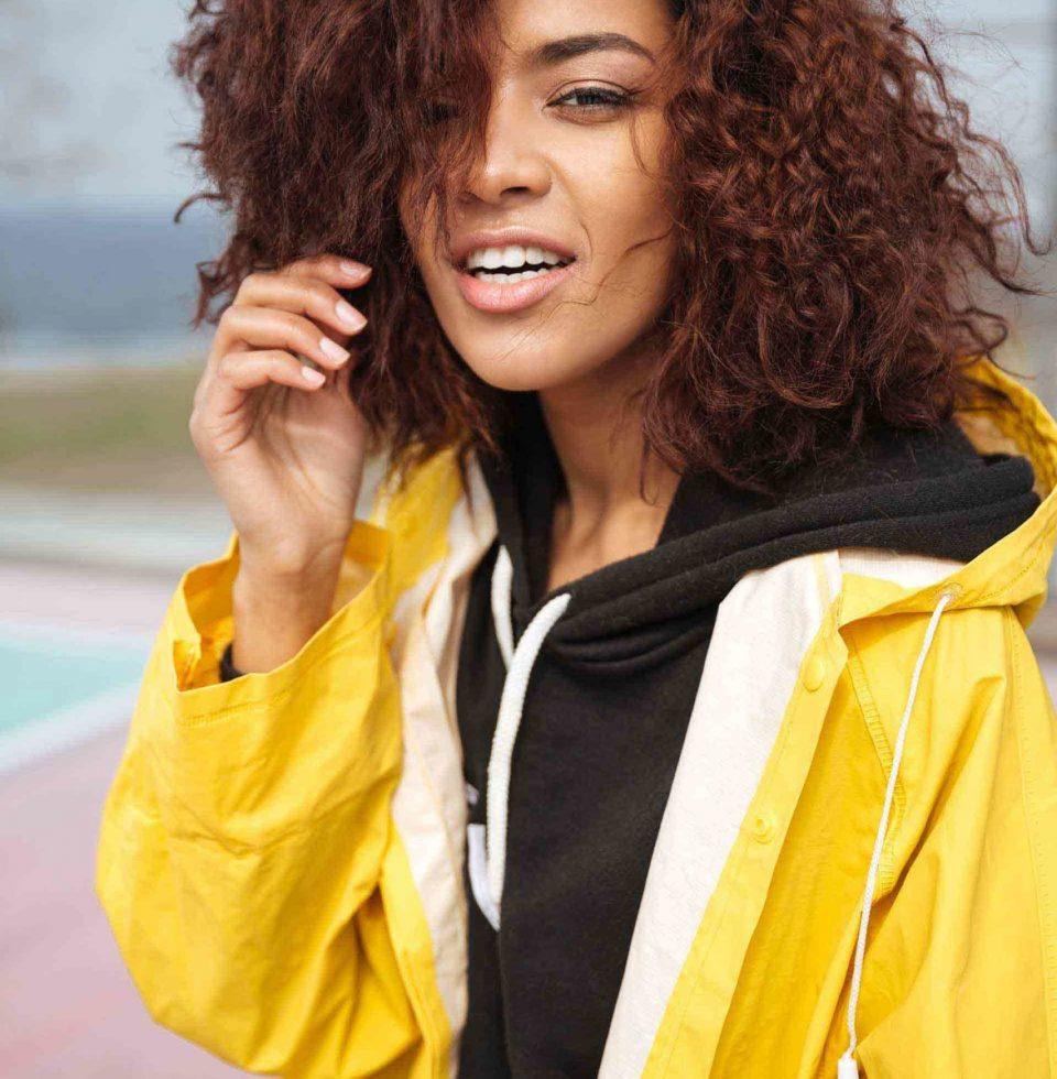 amazing-african-curly-young-woman-wearing-yellow-PCUMRSX-unsplash-1-scaled-e1582915738884.jpg
